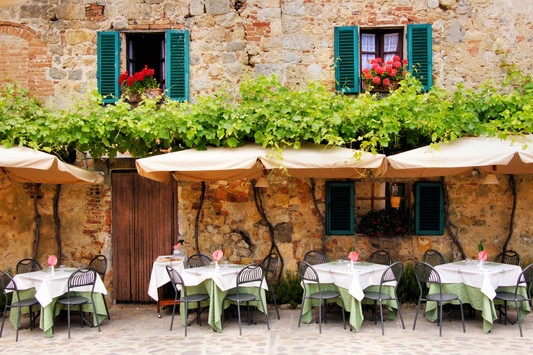 Cafe tables and chairs outside a quaint