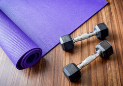 Workout equipment, two dumbbells and yog