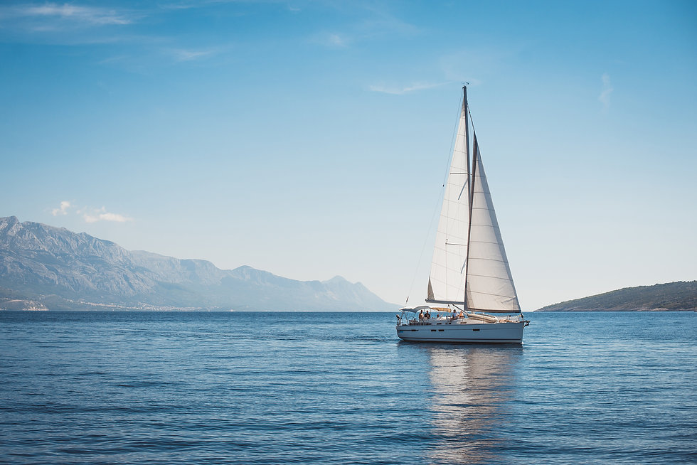 Sailing yacht in the sea against the bac