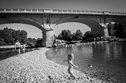 swimming under bridge