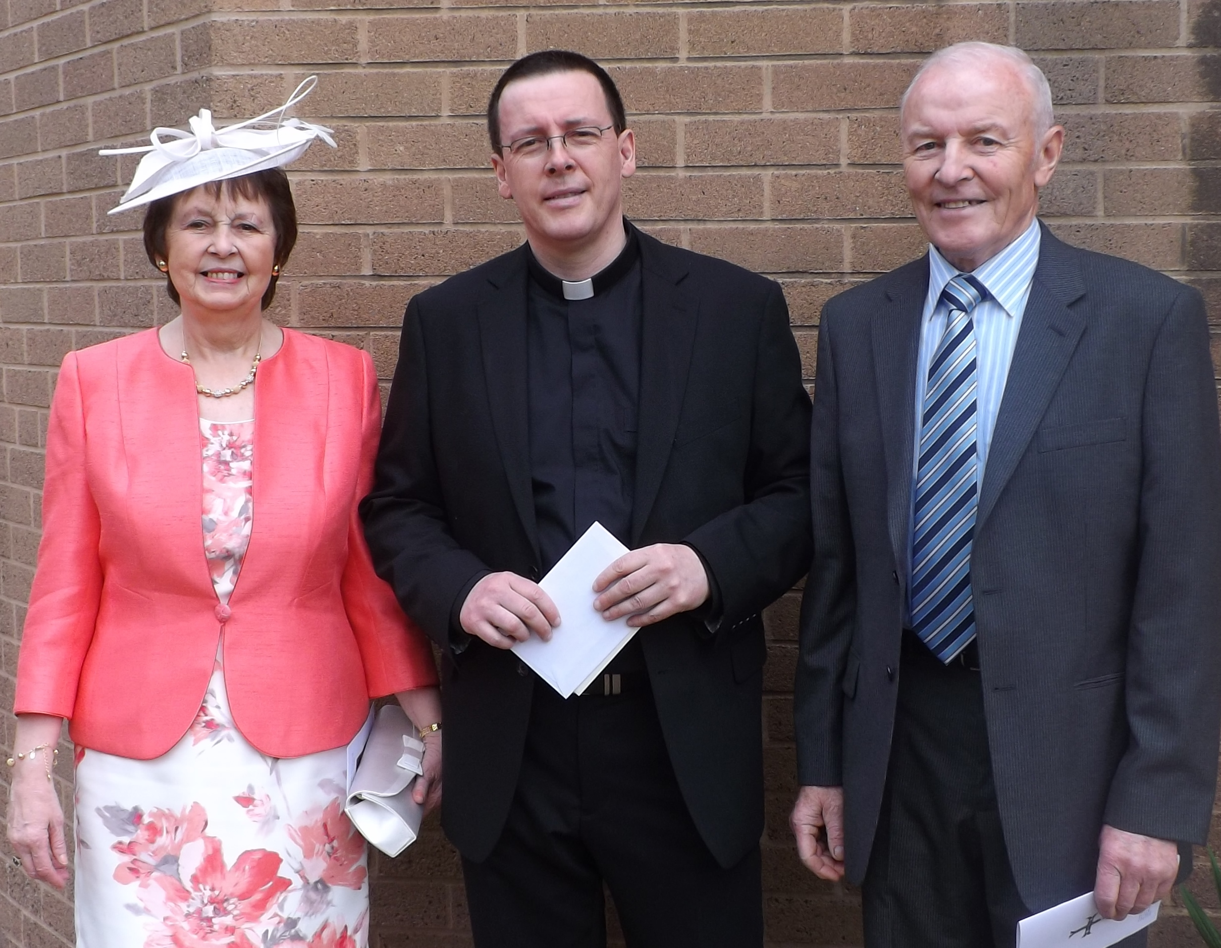 Father James Travers with his mother & father