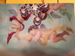 Baby room Cherub mural on ceiling.