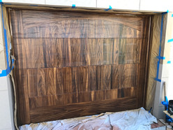 Faux pecky cypress on a metal garage door