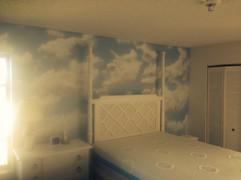 Sky mural on wall.