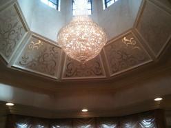 Silver leaf design on ceiling panels