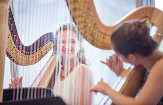 Melanie performs at the USA International Harp Competition