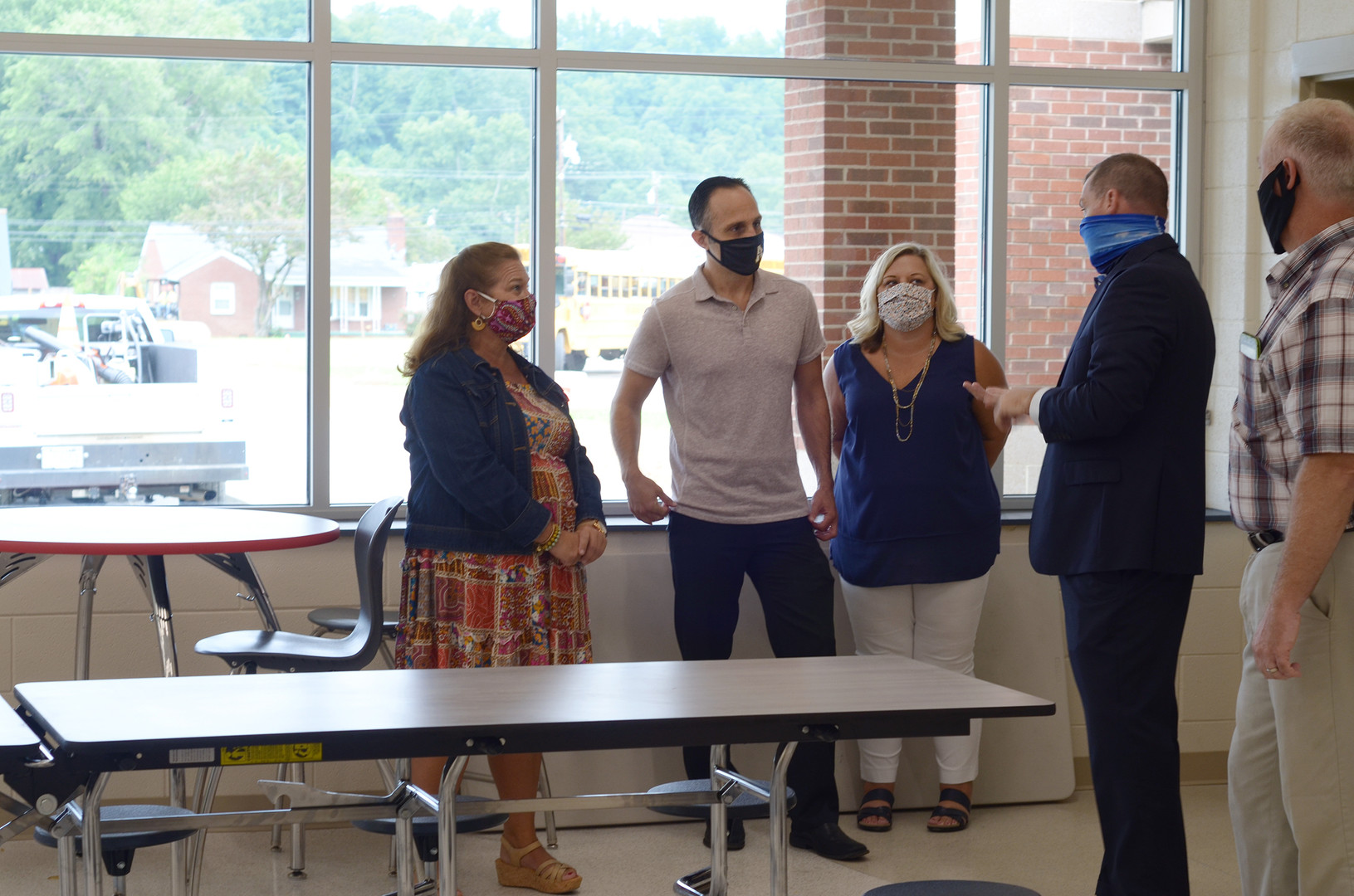 From left, Old Fort Elementary Principal Jill Ward, Josh Dobson, N.C. Representative and candidate for Commissioner of Labor, and his wife Valerie Dobson,  McDowell County Schools Superintendent Mark Garrett, and McDowell County Schools Board Member Patrick Ellis discuss the building project in the school's new cafeteria.