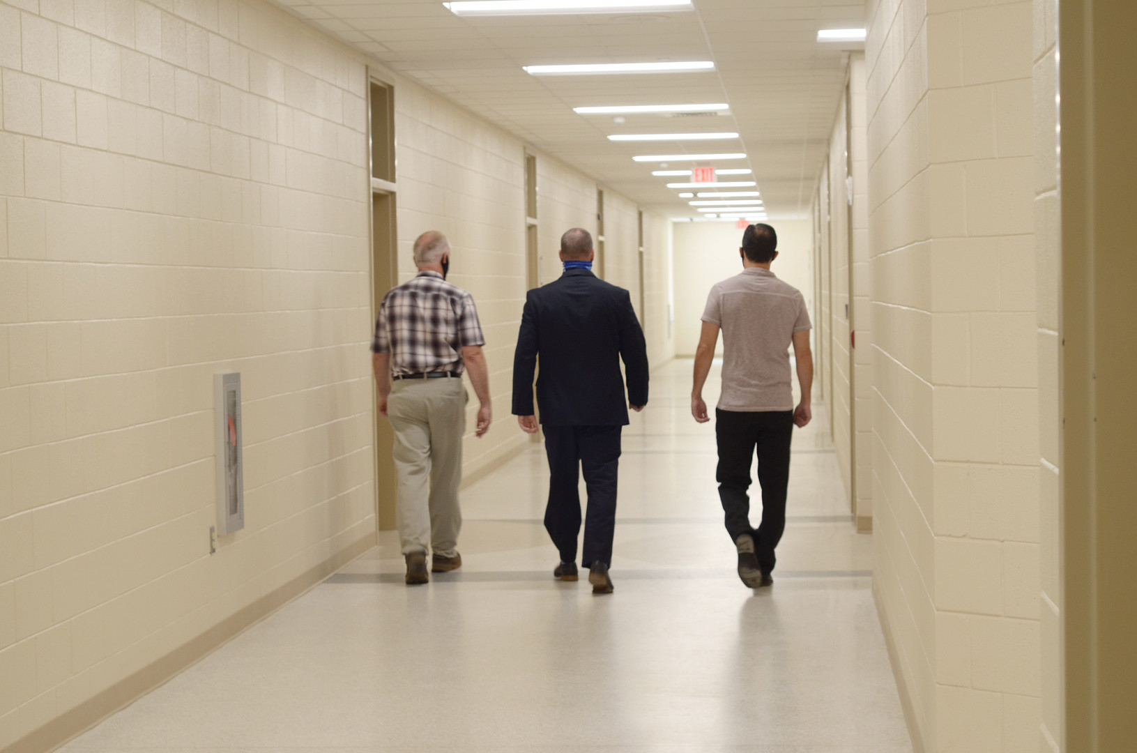From left, McDowell County Schools Board Member Patrick Ellis, Superintendent Mark Garrett, and N.C. Representative and Labor Commissioner Candidate Josh Dobson walk through the hallways of the new school during a tour on Monday.