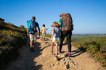 family-of-travelers-with-backpacks-walki