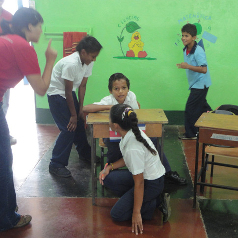 Children explore their reactions to a natural disaster using Image Theatre. Cinchona Elementary School, Costa Rica