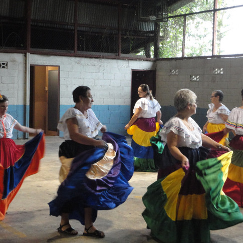Senior Citizens perform cultural heritage to younger generations.Cinchona, Costa Rica