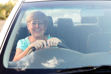 happy senior woman driving a car.jpg