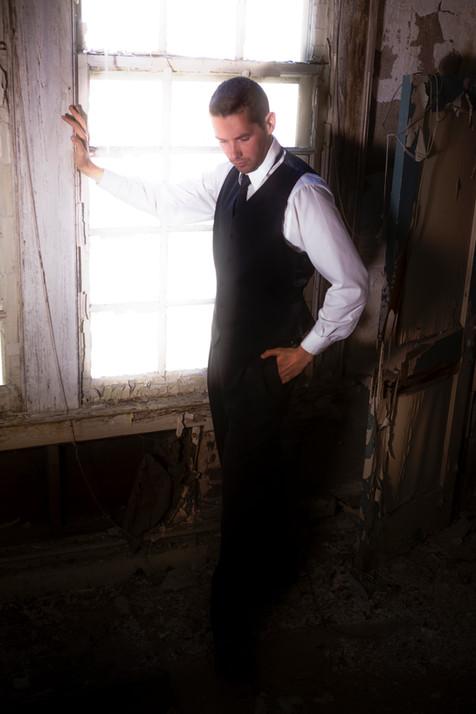 Matt at window in dusty room.jpg