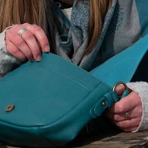 Teal vegan friendly leather saddle bag