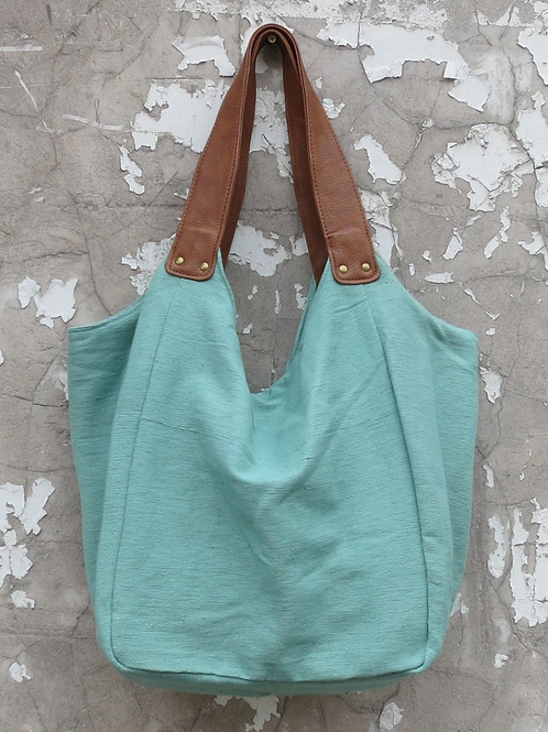 Aura Que Hava bag in mint green