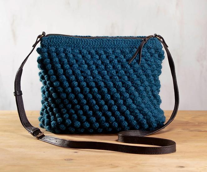 Aura Que Huri bobble bag in turquoise