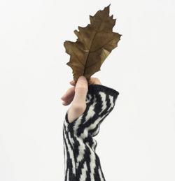 Lambswool wrist warmers in monochrome zebra print