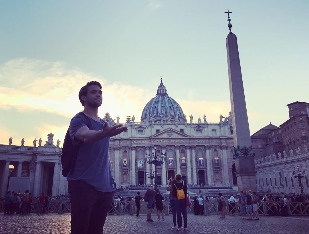 Dan acts like a statue, welcoming everyone to St. Peter's Square.