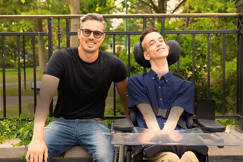 Photo of Brad and Dan smiling in a park