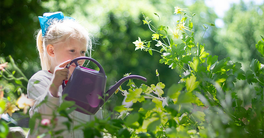 Private Elementary School Student in Madison, WI learning gardening and nature.