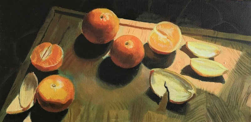 Oranges on chopping board