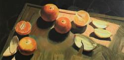 Oranges on chopping board