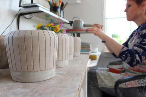 MAKA Ceramics, Marz decorating coffee cups - Irish Pottery