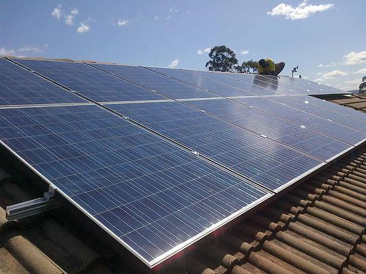 solar-panels-roof-with-team-yellow-shirt-3-min.jpg