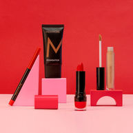 Playful composition with blocks and cosmetics with a red and pink background