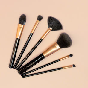 Top shot of brushes on a nude background