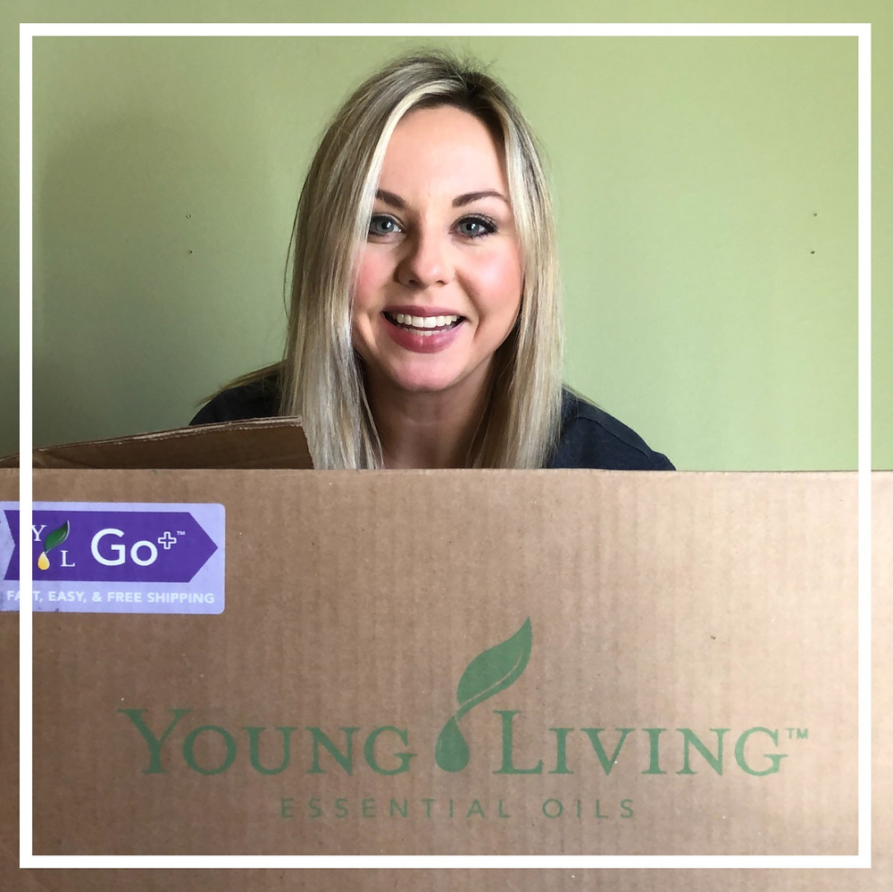 image of emily with young living box