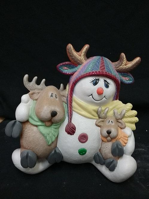 Snowman with deer friends