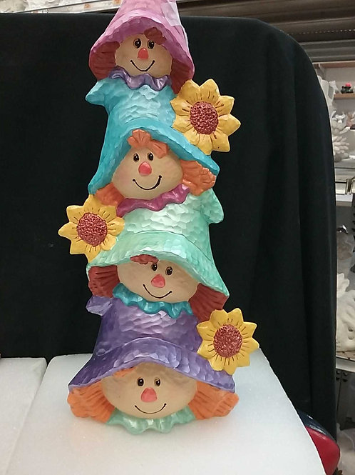 Stack of scarecrows