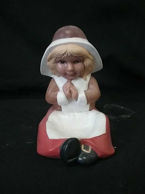 Pilgram girl sitting