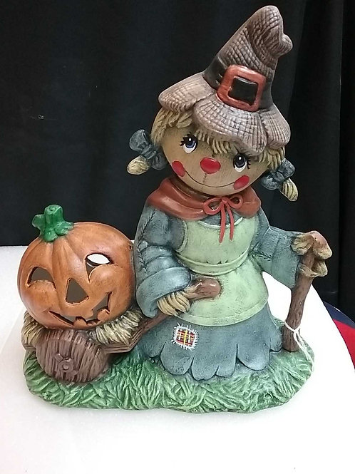 Scarecrow girl with pumpkin wagon