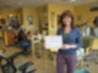 Mary Oswald, owner of San Juan Hand Therapy in Durango, Colorado accepts a certification from the Thrive! living wage coalition. Mary believes that paying employees a living wage is a critical aspect of being an ethical business.