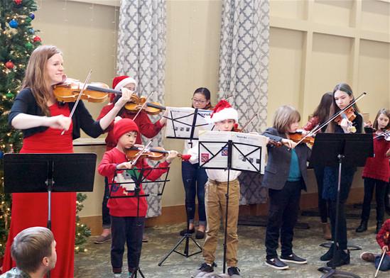 Caroling violinists.jpg