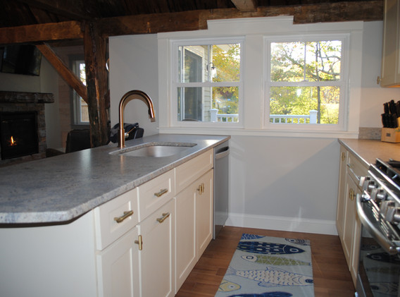 Full Kitchen, honed granite counters, overlooking deck and water