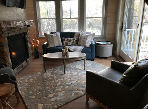 Cottage Living Room with Double Sided Gas Fireplace