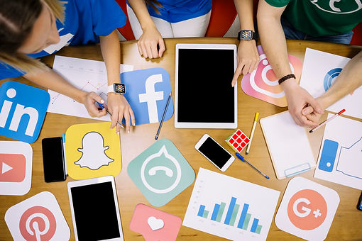 overhead-view-of-team-working-on-social-media-applications.jpg