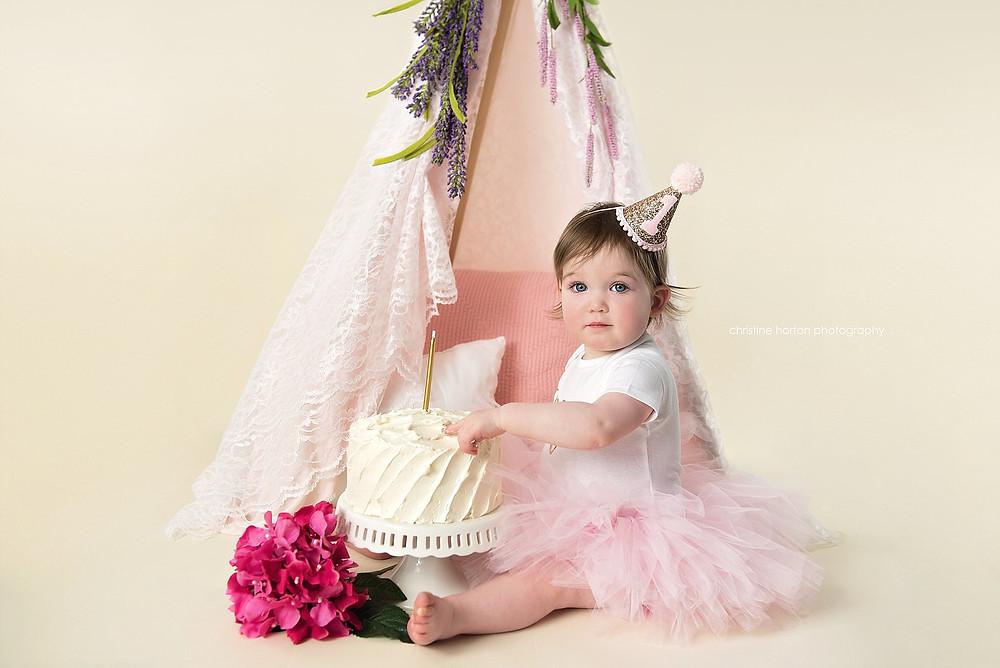 first birthday girl, cake smash, flower tent