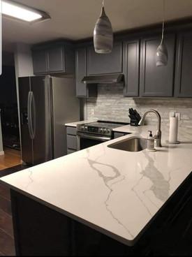 level 3 white granite kitchen