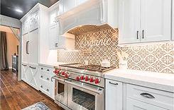 white granite kitchen with white cabinets