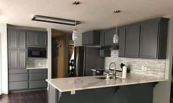 white granite kitchen with grey cabinets