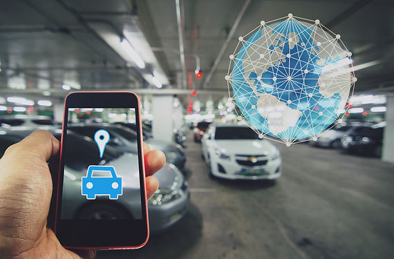 Smartphone in hand with car symbol and w