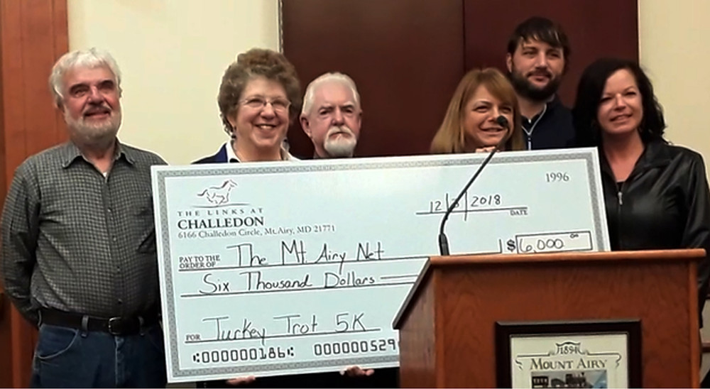 heck Presentation to Mount Airy Net, proceeds of Mount Airy Turkey Trot