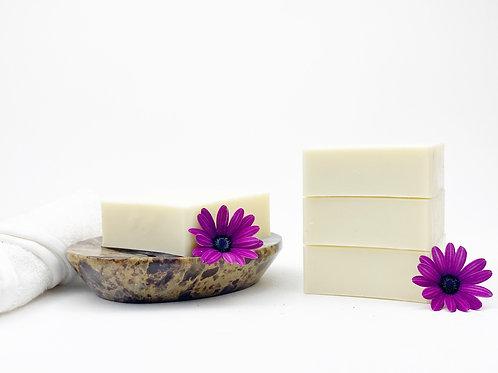 white castile artisan soap bars on a dish rosemary