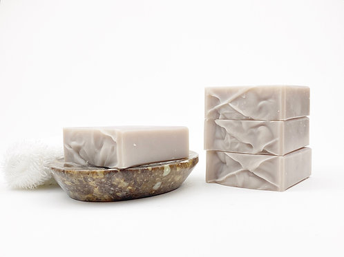 light purple soap bar on a soap dish handcrafted