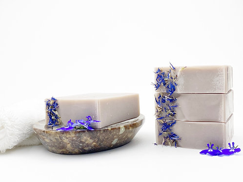 handcrafted purple soap on a dish essential oil scent