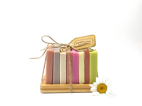8 halves of soap on a bamboo dish ribbon tag